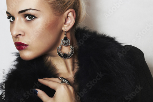 beautiful blond woman.Jewelry and Beauty. Fur.red lips