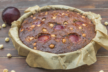 Plum, hazelnuts and chocolate home baked cake