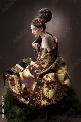 A girl wrapped in an old rug