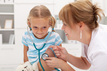 Little girl at the doctor for a checkup