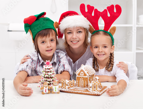 Happy family at christmas time with gingerbread house