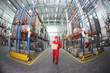 worker in red uniform with box in  warehouse in fish-eye lens