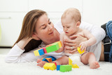 Baby boy playing with colorful blocks