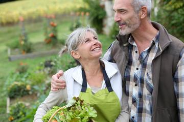 Husband and wife enjoying being in kitchen garden