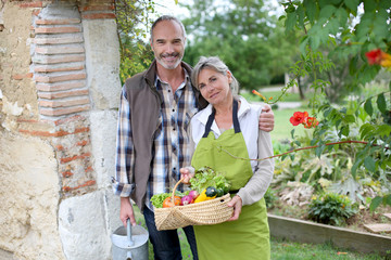 Husband and wife enjoying being in kitchen garden
