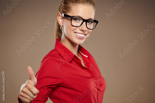 Happy smiling cheerful young business woman with okay gesture, o
