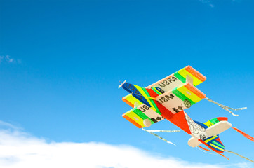 colorful toy plane over blue sky.