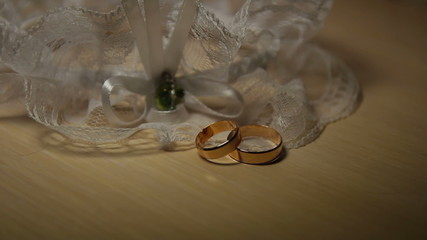 Two wedding bands on a table. Close-up