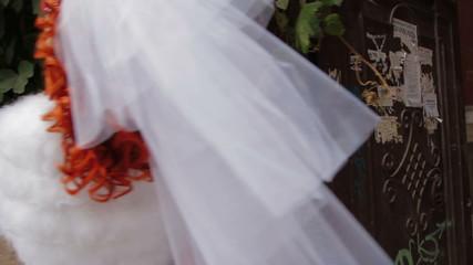 Bride posing for cameras with a wedding bouquet