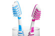 Head Toothbrush standing in a glass on a white background