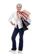 fashionable senior woman carrying shopping bags