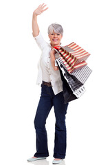 middle aged shopper waving goodbye