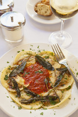 ravioli filled with beef, pork and mushrooms