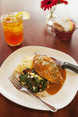 crispy fried chicken with mashed potato and chard