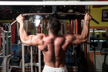Bodybuilder Doing Exercise For Back