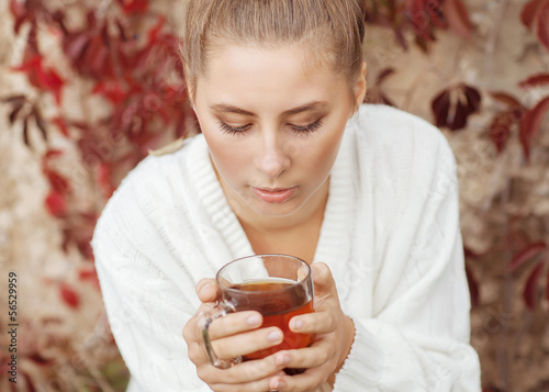 Girl enjoying a large cup of freshly brewed hot tea