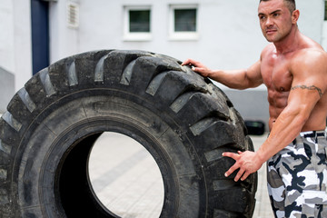 Muscular Man Resting After Tire Workout