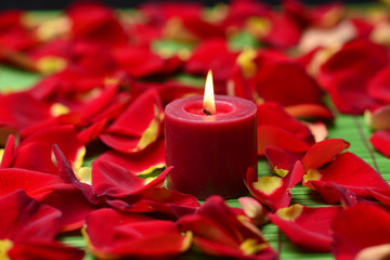 Spa composition of rose petals and candle