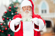 Santa Claus Showing One Dollar Note