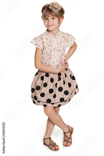 Fashion smiling young girl on the white