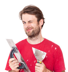 Winking worker with wall plastering tools isolated on white