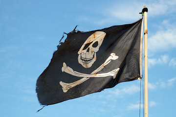 Run down black and white pirate flag