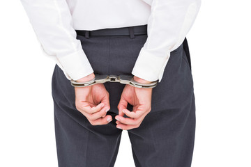 Close up on classy businessman wearing handcuffs