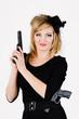 beautiful woman holding a gun