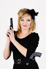 beautiful woman holding a gun