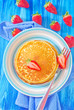 pancakes on plate and fresh strawberries