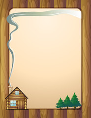 A wooden frame with a house and trees