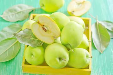 fresh apples in yellow box
