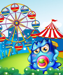 A baby blue monster at the carnival