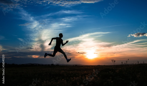 Silhouette man running and jumping