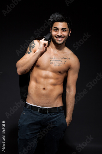 Sexy man with great abs over black isolated background