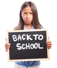 Sad girl holding a chalkboard on a white background