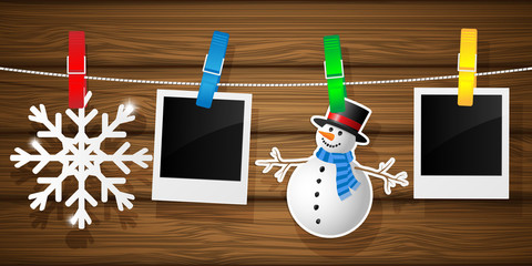 Blank photo frames and snowflakes on a clothesline. Vector.