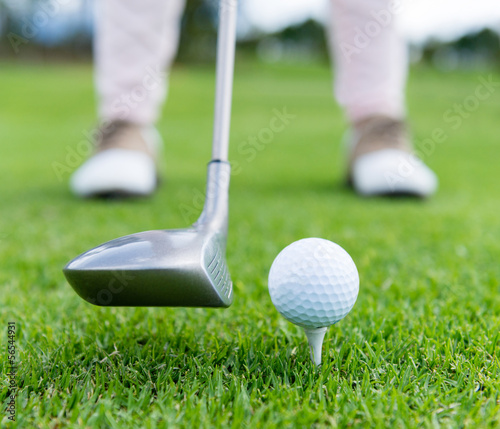 Golf player at the tee