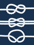 White navy rope with nautical knots on dark blue background