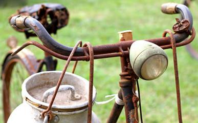 Rusty milkman's bike with aluminium drum and lights