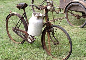 rusty bikes of ancient milkman with aluminium drum