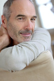 Closeup of relaxed and serene senior man poster