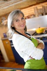 Portrait of senior woman in home kitchen