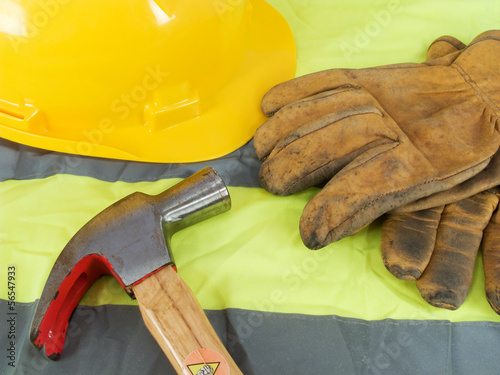 Yellow hardhat, old leather gloves, reflective vest and a hammer