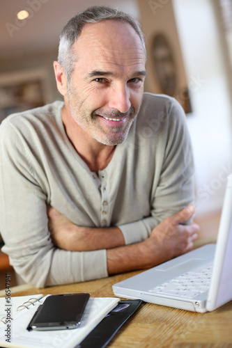 Mature man working from home