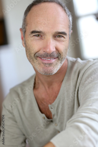 Portrait of handsome mature man at home