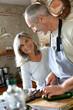 Senior couple in kitchen preparing dinner