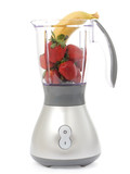 Blender with strawberries and bananas isolated