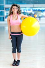 Gym woman holding a Pilates ball