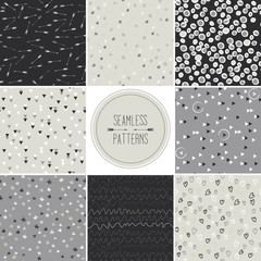 Seamless patterns with dots,arrows,hearts,stars,triangles